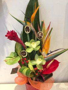 Composition fleurs exotiques - 32€